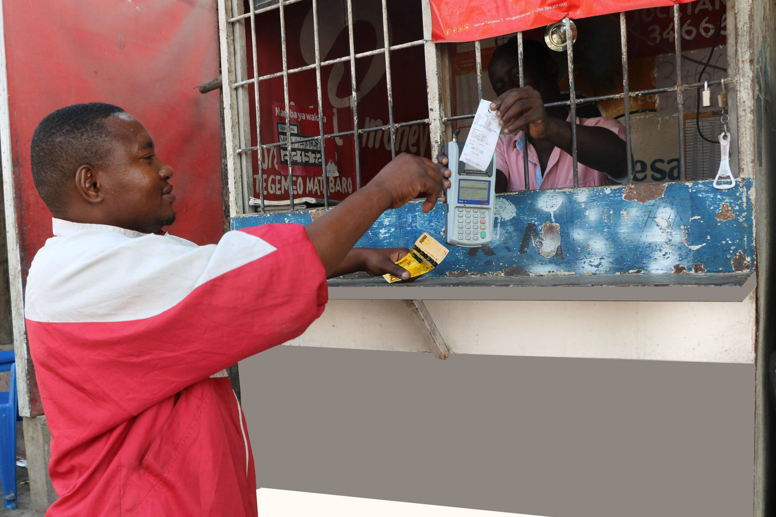 Man conducting banking transaction at a kiosk through Agency banking