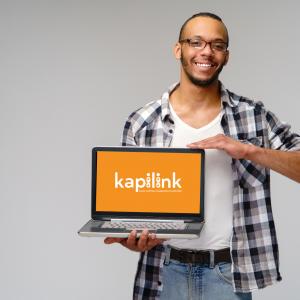 man holding laptop showing Kapilink features